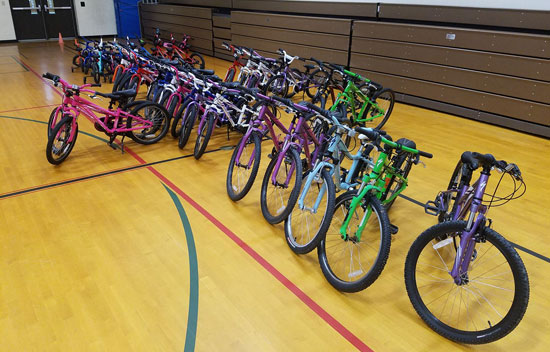 McLain Cylcle surprised students at Courtade and Westwoods with bikes.