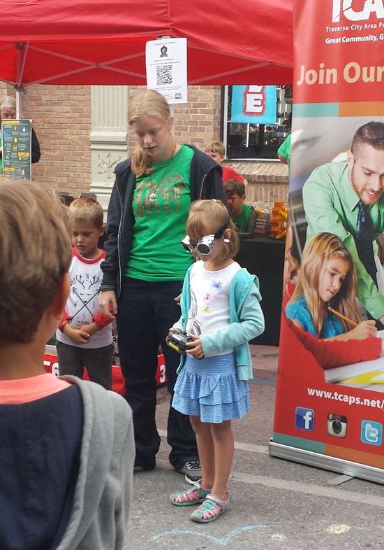 Kids visiting the TCAPS booths at Friday Night Live had the opportunity to play with robots.