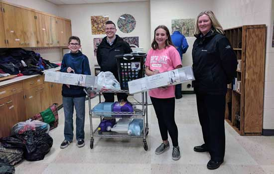 Price Point staff delivers supplies for Giving Closet